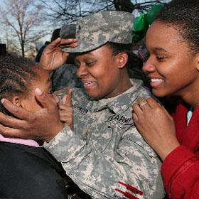 Military family reunited after deployment.