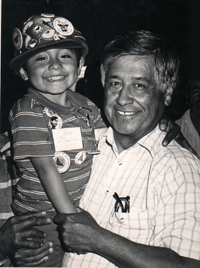 Cesar Chavez with a young child