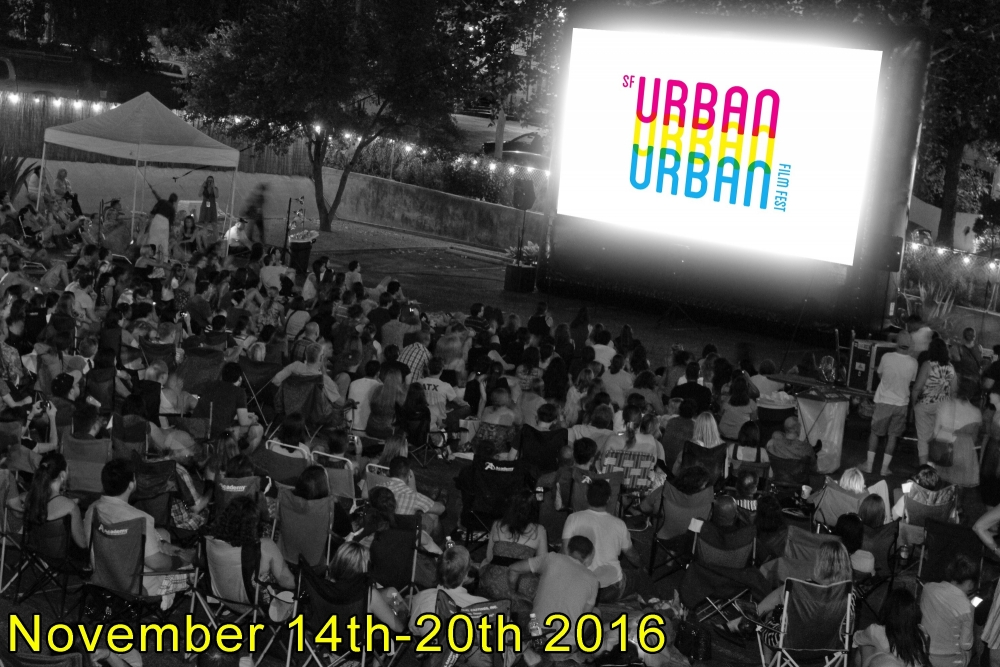"""Black and white photo, with people looking up at a movie screen with the words """"SF Urban Film Festival"""" in color"""