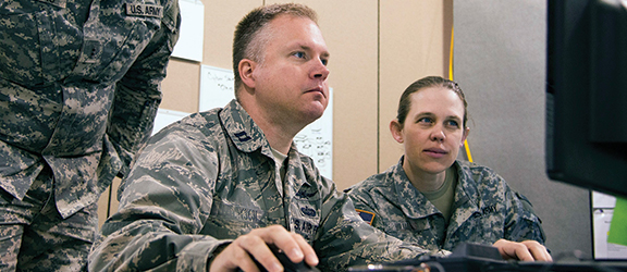 Image of a Army soldiers taking an online class