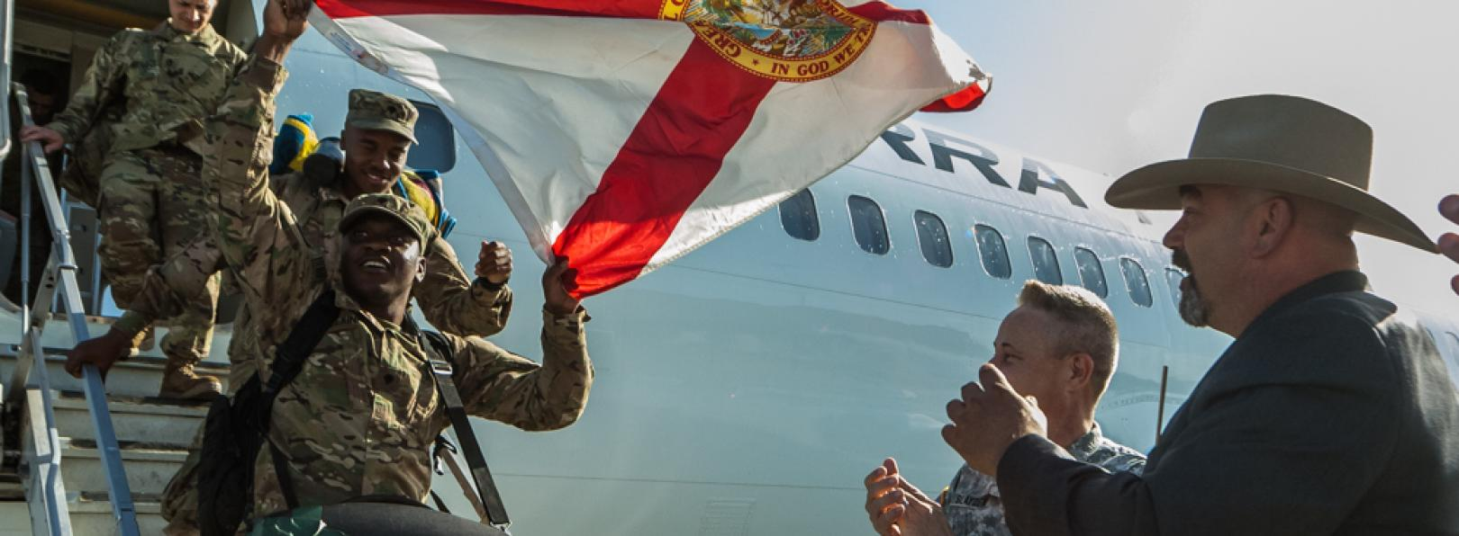 Soldiers Getting Off Plane