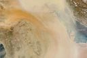 This huge dust storm over the Middle East, shown in a March 18, 2012 MODIS image, is the subject of a 2015 paper that utilized MODIS data available in Giovanni.
