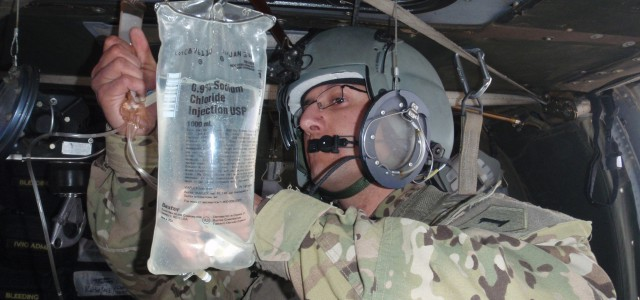 Specialist Israel Figueroa, a medic with Company C, 2nd General Support Aviation Battalion, 1st Aviation Regiment, prepares an IV bag for use during an unpartnered medical evacuation mission in support […]