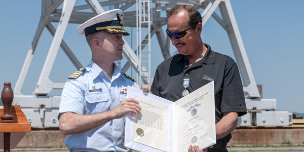 Coast Guard awards Silver Lifesaving Medal for heroic rescue in Duluth Harbor in 2013