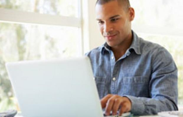 Man with a laptop renewing online
