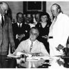 President Franklin D. Roosevelt signs the Social Security Act, 1935.