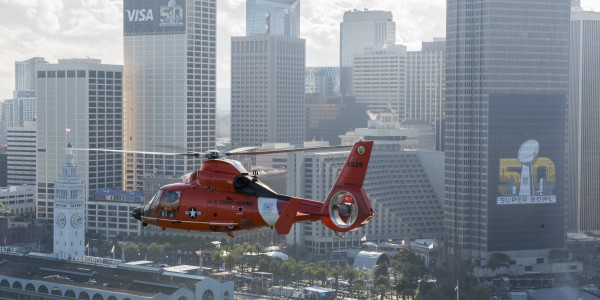 A Coast Guard San Francisco helicopter crew flies near Super Bowl city in San Francisco Feb. 5, 2016.  U.S. Coast Guard photo by Petty Officer 3rd Class Adam Stanton.