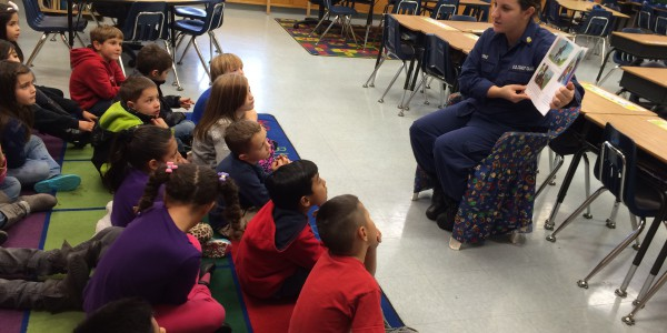 "Petty Officer 1st Class Dorothy Burke reads to children from the book ""Little Erroll"" during a Partenrship in Education reading event in Petaluma, California. U.S. Coast Guard photo."