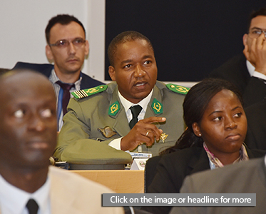 Col. Mahamadou Seidou Magagi, aide de camp for the Niger Office of the Presidency, asks a question during the Defining and Applying Security presentation of the George C. Marshall European Center for Security Studies' Program on Applied Security Studies at the Marshall Center in Garmisch-Partenkirchen, Germany.