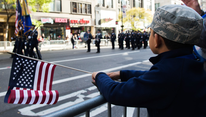 Kid watching honor guard during parade