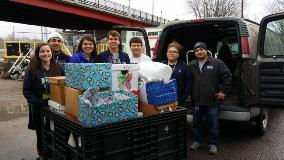 Topeka Hayden High School students help with the Department of Administration Holiday Food Drive.