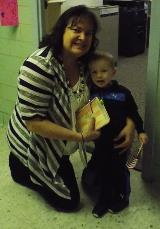 Sonia Sprouse and grandson John-Paul deliver cards to Topeka Veterans.