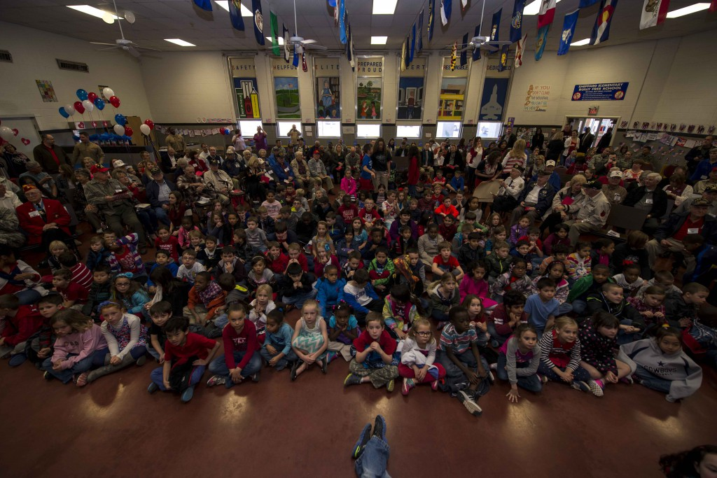 Children from Sheppard Elementary School sit in the cafeteria for the Iwo Jima Survivors 70th Reunion at Sheppard Air Force Base, Texas, Feb. 13, 2015. The elementary school children's choir opened the event with the singing of the U.S. anthem followed by presentations for the Iwo Jima survivors. (U.S. Air Force photo by Senior Airman Kyle Gese/Released)