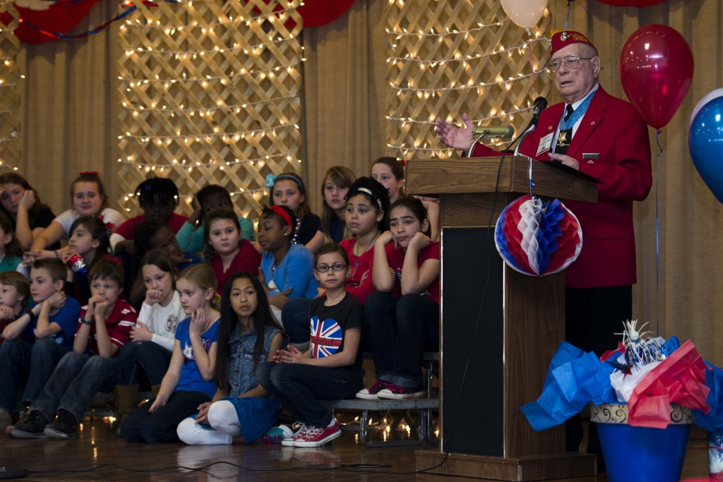 """Hershel """"Woody"""" Williams, Iwo Jima survivor and Medal of Honor recipient, tells a story to the Sheppard Elementary School students during the Iwo Jima Survivors 70th Reunion at Sheppard Air Force Base, Texas, Feb. 13, 2015. Williams shared his story of miracles during the last anniversary for the Iwo Jima survivors. He is the last living Iwo Jima Medal of Honor recipient. (U.S. Air Force photo by Senior Airman Kyle Gese/Released)"""