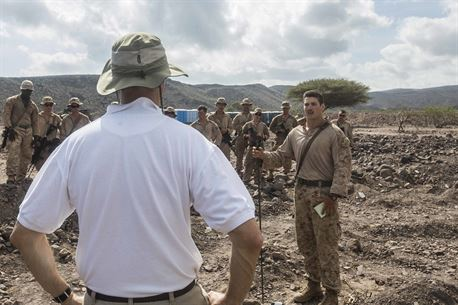 DJIBOUTI, Africa (April 27,2016) --U.S. Marine 1st Lt. Matthew S. Kelley, a platoon commander with the 13th Marine Expeditionary Unit, briefs Tom Kelly, the U.S. Ambassador to Djibouti, before a convoy April 27, 2016, in Djibouti.The 13th MEU is conducting sustainment training to maintain proficiency and combat readiness while deployed with the Boxer Amphibious Ready Group during Western Pacific Deployment 16-1. (U.S. Marine Corps photo by Cpl. Alvin Pujols/RELEASED)