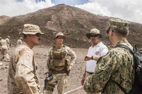 DJIBOUTI, Africa (April 27,2016) --Tom Kelly, the U.S. Ambassador to Djibouti, greets Marines with the 13th Marine Expeditionary Unit before they conduct a live-fire range in Djibouti, April 27, 2016. The 13th MEU is conducting sustainment training to maintain proficiency and combat readiness while deployed with the Boxer Amphibious Ready Group during Western Pacific Deployment 16-1. (U.S. Marine Corps photo by Cpl. Alvin Pujols/RELEASED)