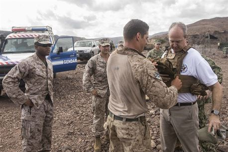 DJIBOUTI, Africa (April 27,2016) --U.S. Marine 1st Lt. Matthew S. Kelley, a Light Armored Reconnaissance platoon commander with the 13th Marine Expeditionary Unit, assists Tom Kelly, the U.S. Ambassador to Djibouti, with proper protective equipment before he travels in a Light Armored Vehicle in Djibouti, April 27, 2016. The 13th MEU is conducting sustainment training to maintain proficiency and combat readiness while deployed with the Boxer Amphibious Ready Group during Western Pacific Deployment 16-1. (U.S. Marine Corps photo by Cpl. Alvin Pujols/RELEASED)