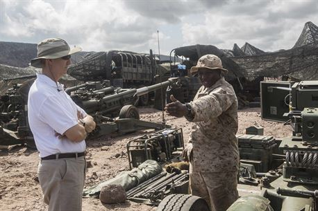 DJIBOUTI, Africa (April 27,2016) --U.S. Marine Sgt. Michael B. Leason Jr., an artillery section chief with the 13th Marine Expeditionary Unit, explains what it takes to fire a M777 Howitzer to Tom Kelly, the U.S. Ambassador to Djibouti, April 27,2016, in Djibouti. The 13th MEU is conducting sustainment training to maintain proficiency and combat readiness while deployed with the Boxer Amphibious Ready Group during Western Pacific Deployment 16-1. (U.S. Marine Corps photo by Cpl. Alvin Pujols/RELEASED)
