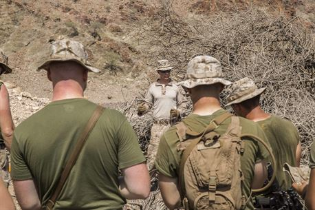 U.S. Marine Staff Sgt. Trent Countryman, an explosive ordnance disposal technician with the 13th Marine Expeditionary Unit, explains different parts of an improvised explosive device training lane in Djibouti, April 22, 2016. The 13th MEU is conducting sustainment training to maintain proficiency and combat readiness while deployed with the Boxer Amphibious Ready Group during Western Pacific Deployment 16-1. (U.S. Marine Corps photo by Cpl. Alvin Pujols/RELEASED)