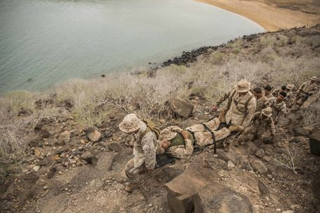 U.S. Marines with the 13th Marine Expeditionary Unit conduct a casualty evacuation drill in Djibouti, April 20, 2016. The 13th MEU is conducting sustainment training to maintain proficiency and combat readiness while deployed with the Boxer Amphibious Ready Group during Western Pacific Deployment 16-1. (U.S. Marine Corps photo by Cpl. Alvin Pujols/RELEASED)