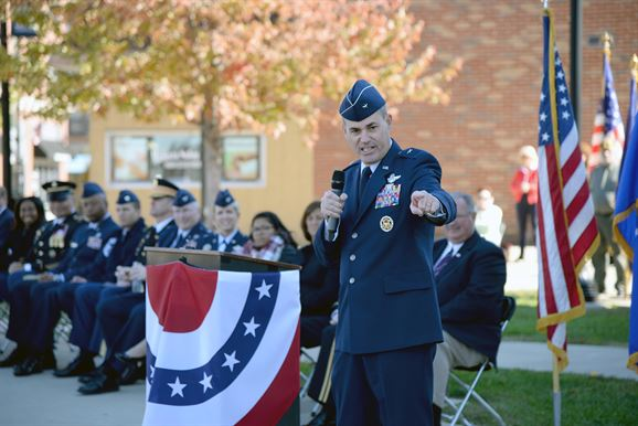 Brig. Gen. Lenny Richoux, 18th Air Force vice commander, thanks veterans for their service and the Belleville community for their support during his keynote address at the Belleville Veterans Day ceremony in downtown Belleville Nov. 11, 2016. Approximately 300 people attended the ceremony during which Richoux asked that they thank veterans when they see them. (U.S. Air Force photo by Master Sgt. Thomas J. Doscher)