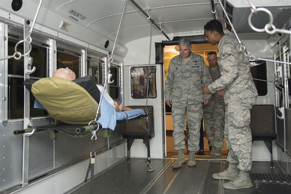 Airman 1st Class Jalen Usher (right), 779th Medical Group aerospace medical technician, shows Lt. Gen. Sam Cox, 18th Air Force commander, how wounded warriors are transported from the flightline to the Aeromedical Staging Facility on Joint Base Andrews, Md., Oct. 20, 2016. The ASF is the first stop that wounded warriors have when they return to the United States. (U.S. Air Force photo/Senior Airman Ryan J. Sonnier/Released)