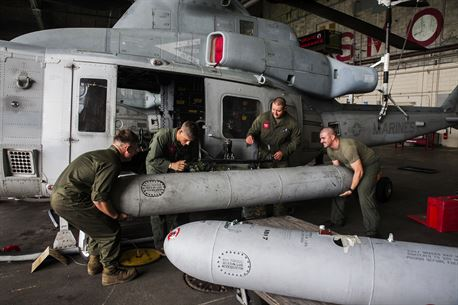 """Auxiliary fuel tanks for the UH-1Y Venom are installed onto the aircraft at Marine Corps Air Station Futenma, Okinawa, Japan, June 14, 2016. This is the first time in the Fleet Marine Force that the tanks will be installed and used. """"For humanitarian missions, we can provide assistance more quickly and farther out,"""" said Maj. Carl A. Bailey, the executive officer of Marine Light Attack Helicopter Squadron (HMLA) 469, Marine Aircraft Group 39, 3rd Marine Aircraft Wing, currently assigned to Marine Aircraft Group 36, 1st Marine Aircraft Wing through the Unit Deployment Program. """"The distances here are extreme, and there is a lot of water and not a lot of gas stations, so being able to strap on these aux-tanks, pick up and go, is going to be a game changer for us."""" The Marines are with HMLA 469. (U.S. Marine Corps photo by Cpl. Tyler S. Giguere)"""