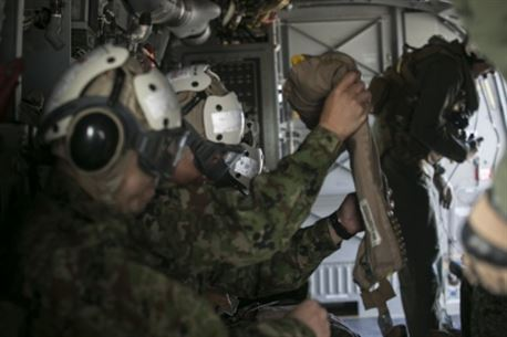Japan Ground Self-Defense Force service members prepare for a flight on an MV-22B Osprey by putting on cranials to protect their head and ears, as well as an inflatable vest in case of emergency over a body of water, during their visit to Marine Corps Air Station Futenma, Okinawa, Japan, March 8, 2016. U.S. Marine crew chiefs give safety briefs to their passengers before each flight, explaining emergency exits, evacuation steps. The Japanese service members visited MCAS Futenma to strengthen relations in the Asia-Pacific and to view the capabilities of the Osprey firsthand. The Osprey is with Marine Medium Tiltrotor Squadron 262, Marine Aircraft Group 36, 1st Marine Aircraft Wing, III Marine Expeditionary Force. (U.S. Marine Corps photo by Cpl. William Hester/ Released)