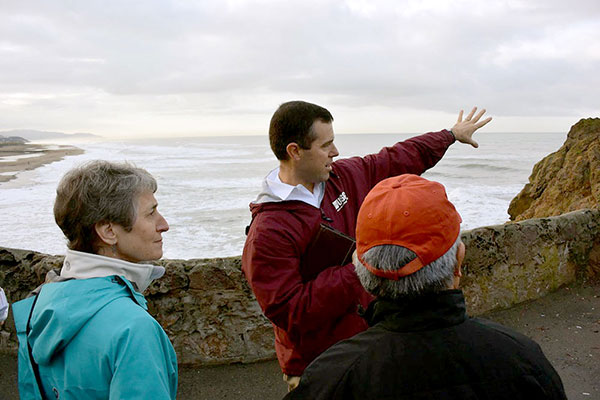 USGS geologist Patrick Barnard tells Secretary of the Interior Sally Jewell and San Francisco Mayor Ed Lee about the coastal hazards facing Ocean Beach.