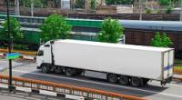 Freight truck driving along a roadway parallel to a rail yard with trains.