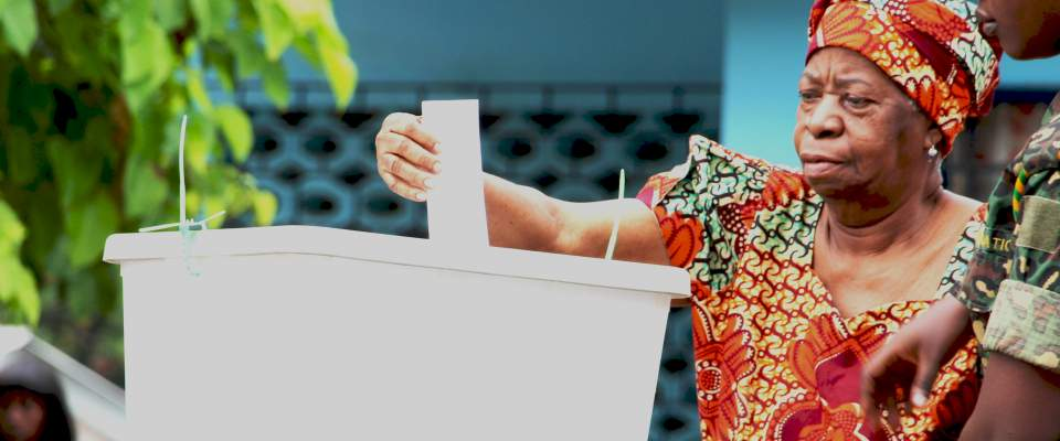 An old woman votng in the 2015 District Level Election in Ghana