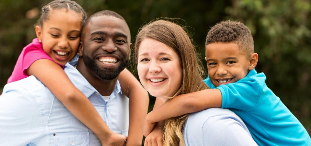 This is a picture of a family smiling.