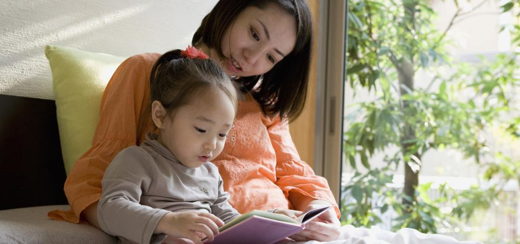 This is a picture of a mother reading to her daughter.