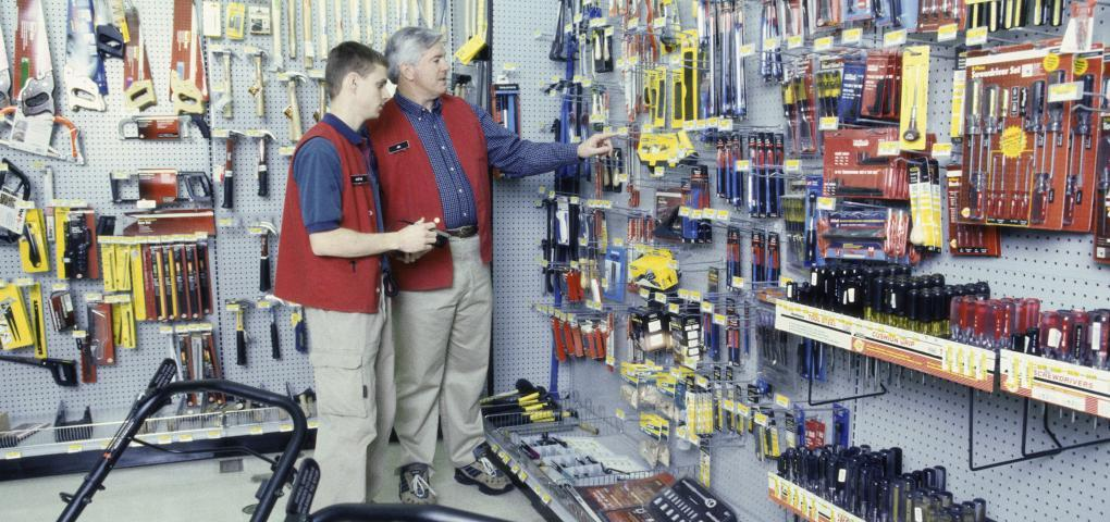 This is a picture of two men in a hardware store.