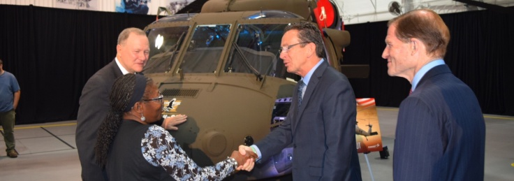 Governor Malloy shakes hands with a worker at Sikorsky in Stratford