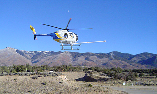 Photo of helicopter with remote sensing equipment