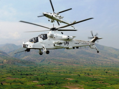 Two Rooivalk attack helicopters painted in United Nations colours in the DRC.