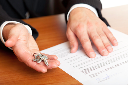 Image of hands with paper and keys