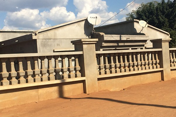 'Business is good': Romanesque villas line a road in Magude, Mozambique, a key staging post in the multibillion dollar illegal wildlife trade
