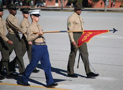 Private First Class Jason P. Gautreaux, honor graduate of platoon 3090, presents his gudon during the pass and review during graduation Nov. 10, 2016, aboard Marine Corps Recruit Depot Parris Island, South Carolina. Gautreaux was recruited out of Recruiting Substation Houma by Staff Sgt. Spencer T. Brown. (Official Marine Corps photo by Cpl. Diamond N. Peden/Released)