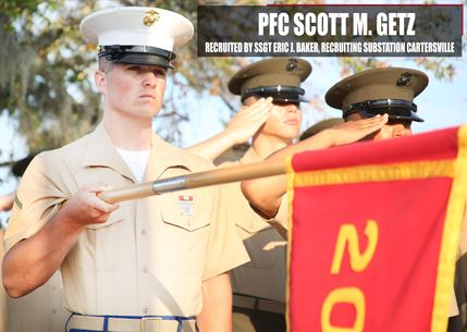 Private First Class Scott M. Getz presents his platoon's guidon before recruit graduation Nov. 4, 2016 aboard Marine Corps Recruit Depot Parris Island, South Carolina. Getz was recruited out of Recruiting Substation Cartersville by Staff Sgt. Eric J. Baker. (Official Marine Corps photo by Cpl. Diamond N. Peden/Released)