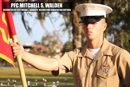 Private First Class Mitchell S. Walden, honor graduate of platoon 2081, holds his guidon at parade rest before graduation Nov. 4, 2016, aboard Marine Corps Recruit Depot Parris Island, South Carolina.  Walden was recruited out of Recruiting Substation  Dothan by Sgt. Drew E. Shorkey. (Official Marine Corps photo by Cpl. Diamond N. Peden/Released)