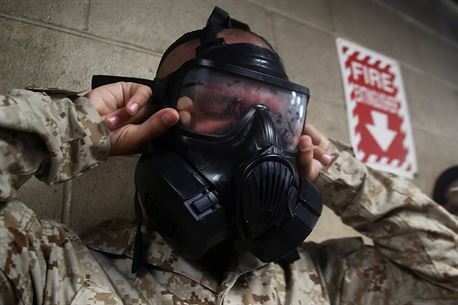 "Recruit Edwin Morales, Platoon 3090, Company M, 3rd Recruit Training Battalion, ""breaks the seal"" on his M50 joint service general purpose mask while in the gas chamber aboard Page Field, Marine Corps Recruit Depot Parris Island, S.C. Morales was recruited by Staff Sgt. Mario Sanchez from Recruiting Substation Fort Myers, Recruiting Station Fort Lauderdale. Morales, a native of Cape Coral, Florida, joined the Marine Corps to become a combat engineer. (U.S. Marine Corps photo by Cpl. John-Paul Imbody/Released)"