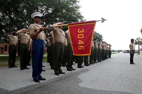 Pfc. Jacob J. Price, honor graduate of platoon 3046, presents his platoon's guidon as the rest of his platoon is saluting before the graduation ceremony, June 3rd, 2016, aboard Marine Corps Recruit Depot Parris Island, S.C. Price, a native of Crawfordville, Fla., was recruited by Staff Sgt. Jacob D. Melrose at Recruiting Substation Tallahassee. To be recommended as an honor graduate, a recruit must not only display honor, courage, and commitment during their three months of training but excel in physical training, knowledge, and have a team player disposition. (Official Marine Corps photo by Cpl. John-Paul Imbody)