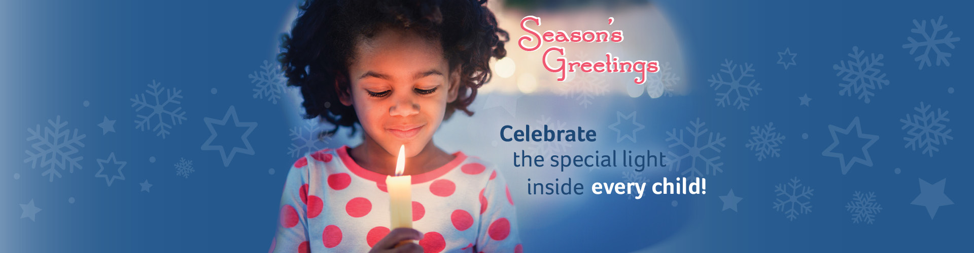 Child holding a candle - links to Winter Break Schedule