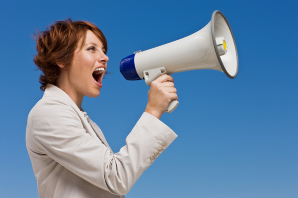 woman-with-a-megaphone-asserting-herself