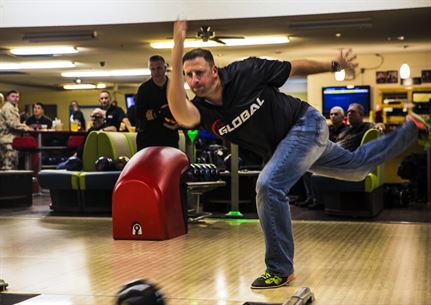 Capt. David Coleman, the aviation safety officer with Headquarters & Headquarters Squadron, stationed out of Marine Corps Air Station Yuma, Ariz., practices his bowling skills at the station bowling alley, Monday, March 14.