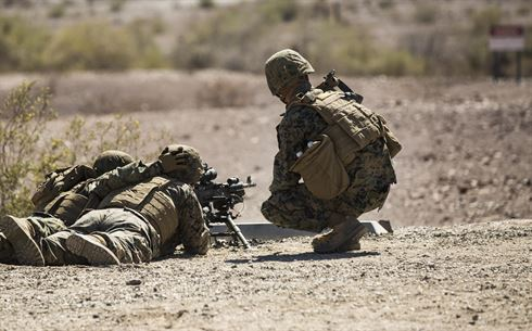 Marines with Marine Wing Support Squadron 371 (MWSS-371), based out of Marine Corps Air Station Yuma, fire an M249 Squad Automatic Weapon (SAW), during a squadron field exercise at the U.S. Army Yuma Proving Ground training facility in Yuma, Ariz., Wednesday, March 9, 2016.