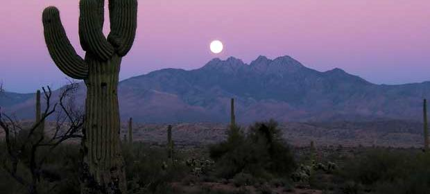 Image of the moonrise over Four Peaks