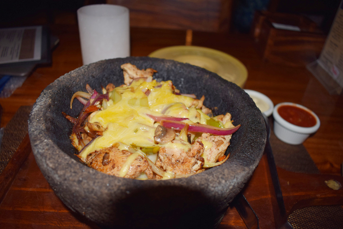 Chicken fajitas in a hot stone bowl at Perlas.